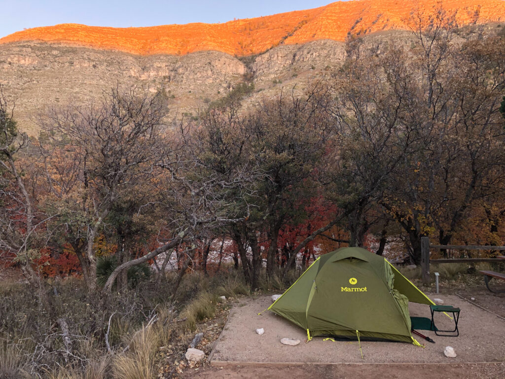 My tent at campsite #6 with the setting sun hitting the top of Dog Canyon in the background.